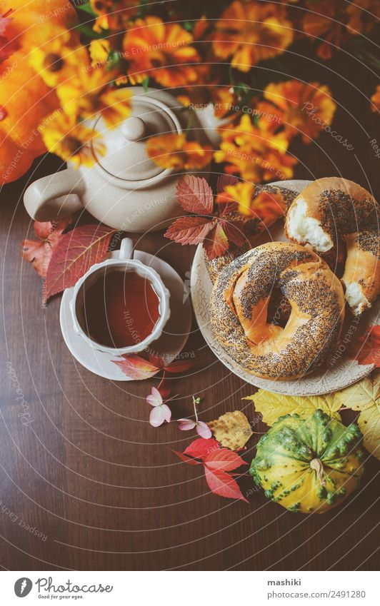 top view of cozy autumn breakfast on table in country house Breakfast Beverage Tea Pot Lifestyle Table Autumn Leaf Wood Brown Safety (feeling of) fall Bagel eat