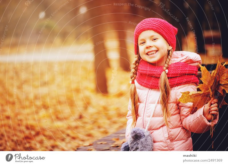 autumn portrait of smiling child girl with bouquet of leaves Child Nature Tree Loneliness Leaf Joy Forest Warmth Autumn Funny Happy Style Small Fashion Pink