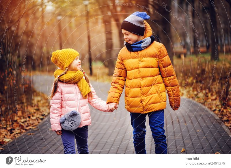 autumn portrait of happy brother and sister walking the road Joy Happy Vacation & Travel Child Sister Family & Relations Friendship Infancy Nature Autumn Leaf