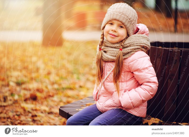 autumn portrait of smiling child girl Child Nature Tree Loneliness Leaf Joy Forest Warmth Autumn Funny Style Happy Small Fashion Pink Leisure and hobbies