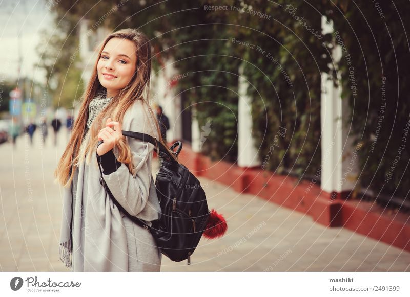 fb1ea642f94ac street style portrait of young beautiful happy girl - a Royalty Free Stock  Photo from Photocase