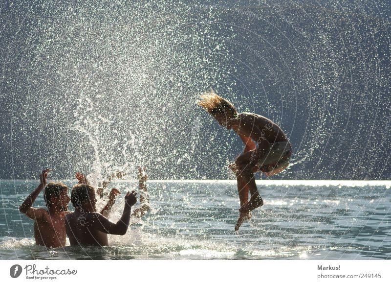 Human being Youth (Young adults) Water Summer Joy Adults Life Playing Jump Swimming & Bathing Blonde Leisure and hobbies Wet Drops of water Crazy 18 - 30 years