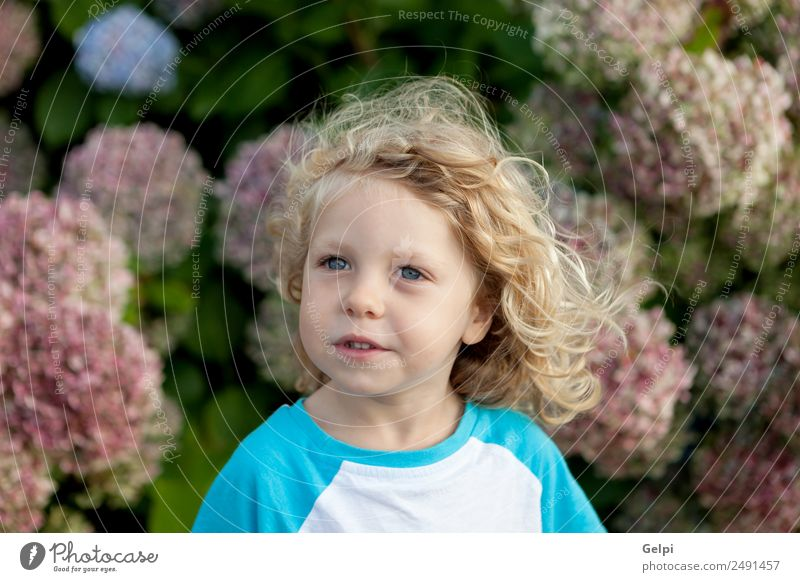 Small child with long blond hair Happy Beautiful Face Summer Garden Child Human being Baby Boy (child) Man Adults Infancy Hand Environment Nature Plant Flower