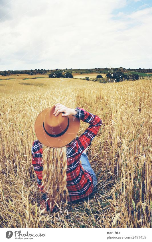 Back view of a young woman in a wheat field Grain Wheat Lifestyle Style Wellness Well-being Relaxation Vacation & Travel Adventure Freedom Summer