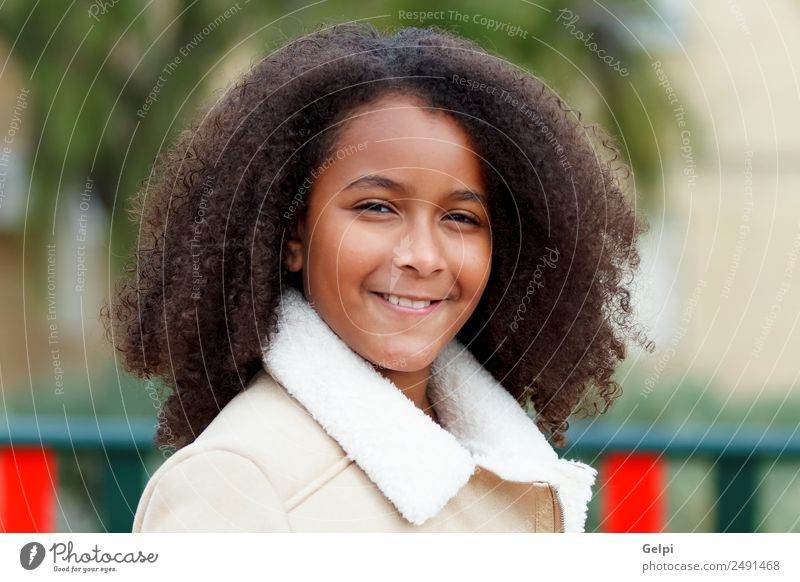 Pretty girl with long afro hair Happy Beautiful Hair and hairstyles Skin Face Child School Woman Adults Sky Warmth Park Coat Afro Cute Colour ten african