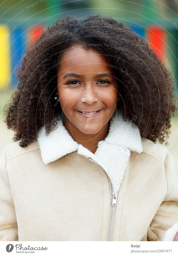 Pretty girl with long afro hair Happy Beautiful Hair and hairstyles Skin Face Child School Woman Adults Sky Warmth Park Coat Afro Cute ten african American