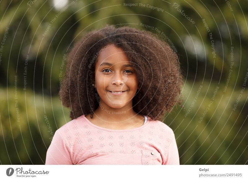 Pretty girl with long afro hair Joy Happy Beautiful Winter Child Human being Toddler Infancy Nature Park Afro Smiling Happiness Small Cute Black Innocent kid