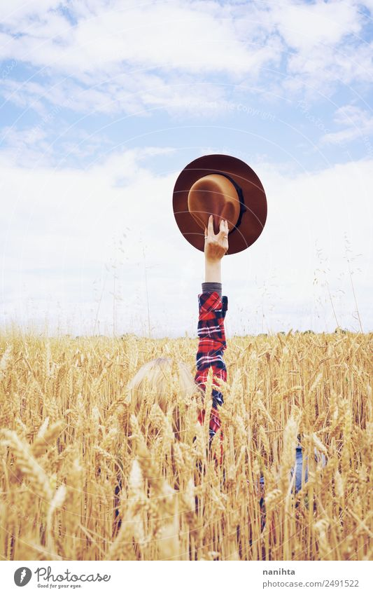 Hand holding a cowboy hat in a field of wheat Grain Wheat Wheatfield Design Joy Freedom Summer vacation Agriculture Forestry Arm Environment Nature Landscape