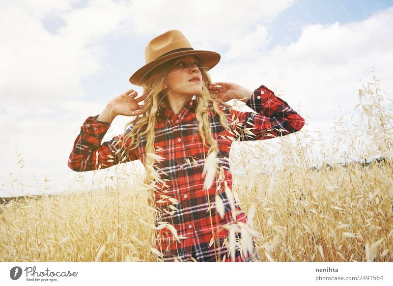 Young woman in a wheat field Woman Human being Sky Vacation & Travel Nature Youth (Young adults) Summer Beautiful 18 - 30 years Healthy Lifestyle Adults Warmth