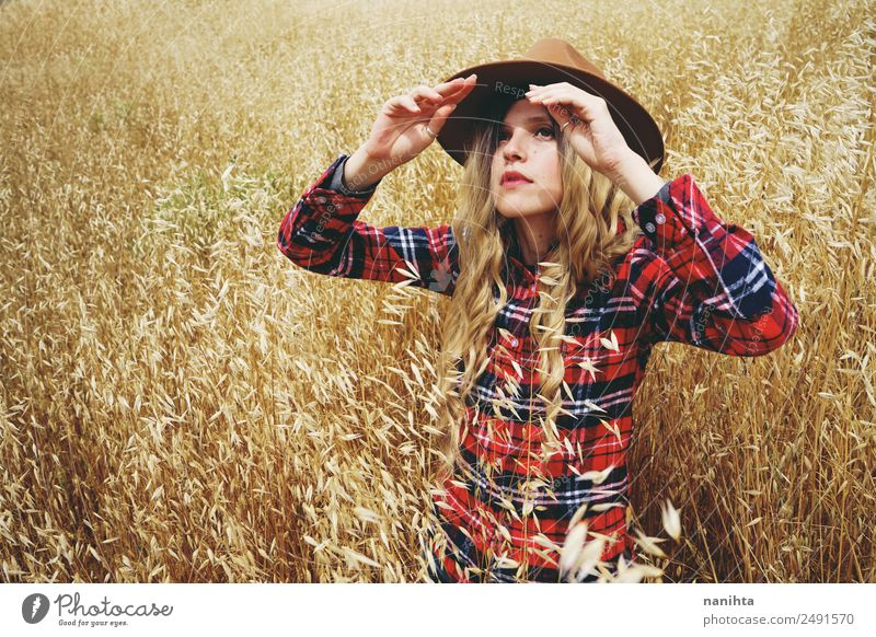 Young woman covering from sun in a wheatfield Grain Lifestyle Style Freedom Summer Summer vacation Sun Human being Feminine Youth (Young adults) 1 18 - 30 years