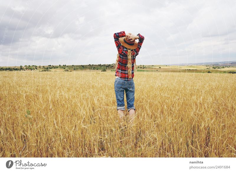 Young woman in a field of wheat Lifestyle Healthy Wellness Well-being Relaxation Summer Farmer Agriculture Forestry Industry Human being Feminine