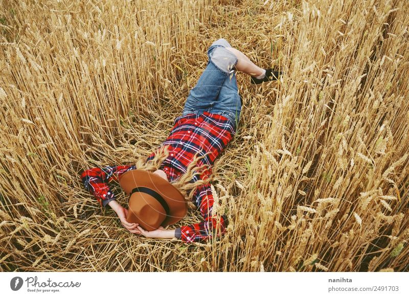 Young woman sleeping in a wheat field Lifestyle Style Design Joy Wellness Relaxation Vacation & Travel Adventure Freedom Summer Summer vacation Agriculture