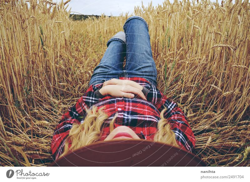 Young woman resting in a field of wheat Lifestyle Wellness Relaxation Summer Summer vacation Agriculture Forestry Human being Feminine Youth (Young adults) 1