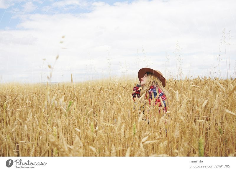 Young woman sitting in a wheat field Food Grain Agriculture Forestry Human being Feminine Youth (Young adults) Woman Adults 1 18 - 30 years 30 - 45 years