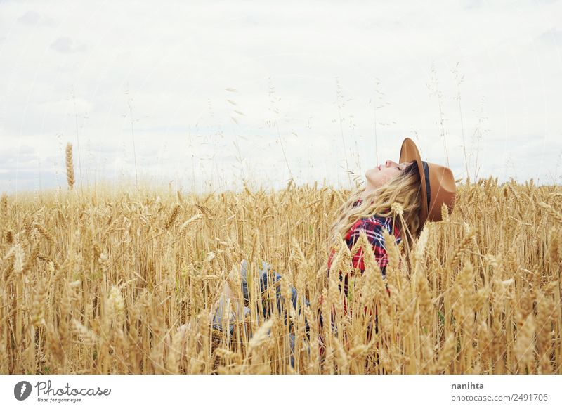 Young woman surrounded by wheat crops Grain Wheat Wheatfield Organic produce Lifestyle Style Joy Wellness Harmonious Well-being Adventure Freedom Summer