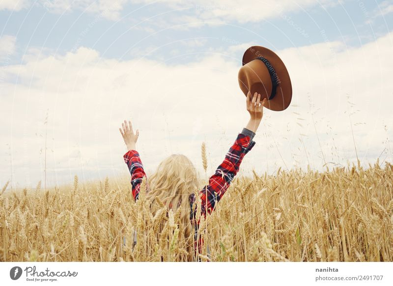 Back view of a young woman in a wheat field Grain Wheat Lifestyle Style Joy Healthy Wellness Harmonious Well-being Vacation & Travel Adventure Freedom Summer