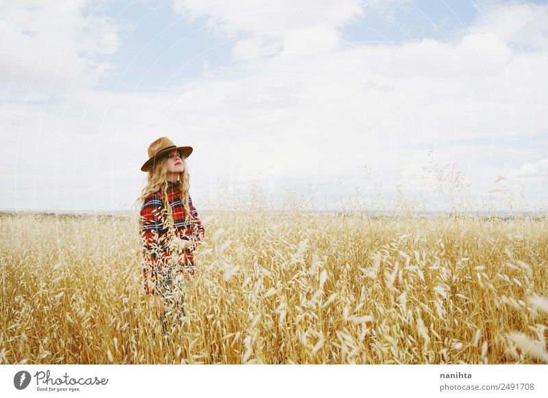 Young woman alone in a field of wheat Grain Lifestyle Healthy Wellness Senses Relaxation Calm Agriculture Forestry Human being Feminine Youth (Young adults)