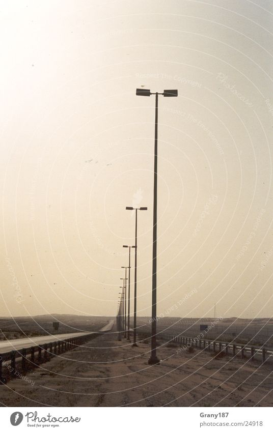 Straight away!!! Lamp Lantern Advertising executive Poster Panorama (View) Vacation & Travel Transport Line Highway Desert Sand Sun Electricity pylon