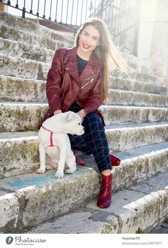 Beautiful blonde girl Woman Adults Friendship Youth (Young adults) Fashion Blonde Animal Pet Dog 1 Smiling Embrace Cute Obedient Peaceful Goodness Friendliness