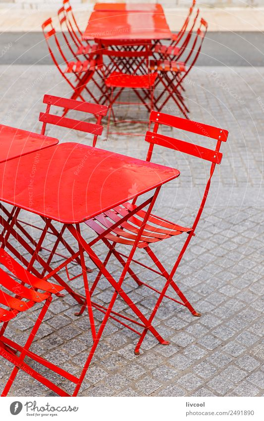 Red chairs and tables from a terrace in a bar Lifestyle Style Design Happy Relaxation Winter Furniture Chair Table Restaurant Gastronomy Village Facade Terrace