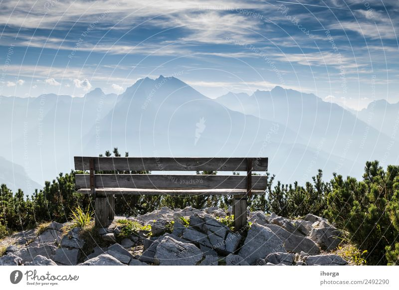 Empty park bench in high mountains Beautiful Relaxation Vacation & Travel Tourism Mountain Hiking Nature Landscape Sky Clouds Grass Park Alps Peak Stone Wood