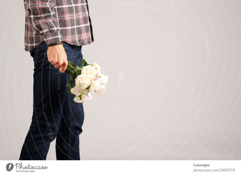 Man in jeans and plaid shirt with some white flowers in his hand Shopping Style Valentine's Day Mother's Day Masculine Adults Hand 1 Human being 18 - 30 years