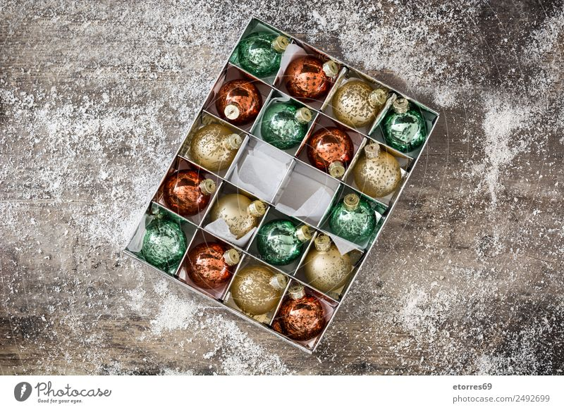 Christmas balls in box on rustic wooden background Vacation & Travel Christmas & Advent Green White Red Background picture Wood Snow Feasts & Celebrations Party