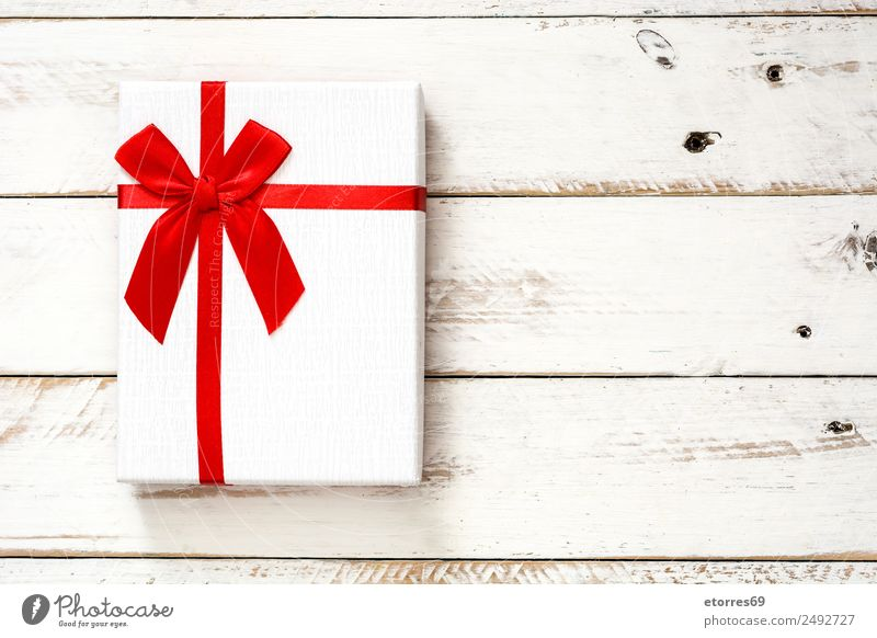 White gift box on white wooden background Vacation & Travel Christmas & Advent Red Feasts & Celebrations Decoration Birthday Gift String Wooden table Packaging