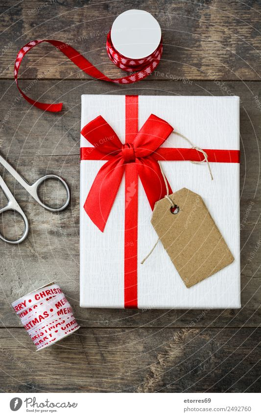 White gift box on wooden background. Christmas & Advent Packaging Box Decoration Souvenir Ornament Red Gift Carton Vacation & Travel Feasts & Celebrations