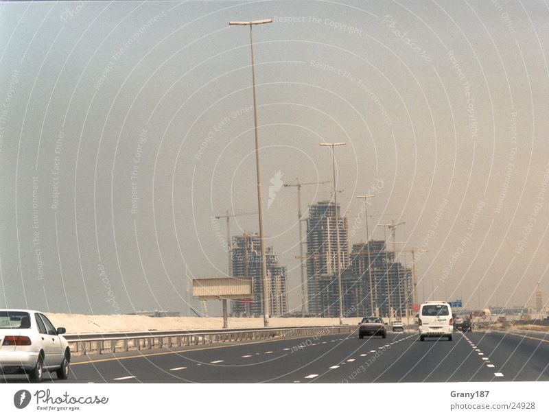 Dubai Boomtown Highway High-rise Construction site Advertising executive Poster Panorama (View) Vacation & Travel Environment Action Success Desert Oil