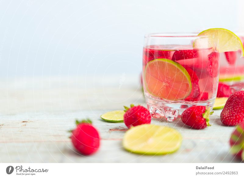 Water with strawberry and lime Summer Green White Red Leaf Wood Fruit Fresh Table Cool (slang) Beverage Berries Refreshment Sense of taste Slice Strawberry