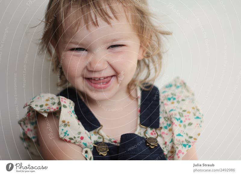 grin tooth gap girl cute Feminine Toddler Infancy 1 Human being 1 - 3 years Blouse Overalls Blonde Short-haired Curl Bangs Laughter Illuminate Brash Free