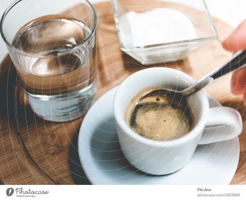 Espresso pleasure. Food Sugar Nutrition Breakfast Lunch To have a coffee Beverage Coffee Water Drinking Hot Stir Glass Colour photo Subdued colour Interior shot