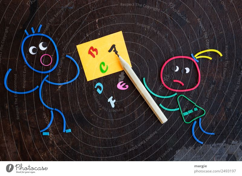 Rubber worms: You never learn! Education Child School Study Blackboard Schoolchild Student Teacher Human being Masculine Feminine Woman Adults Man 2