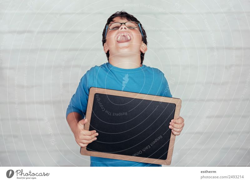happy child with a blackboard Lifestyle Joy Education Child School Blackboard Boy (child) Infancy 1 Human being 8 - 13 years Movement To hold on Smiling