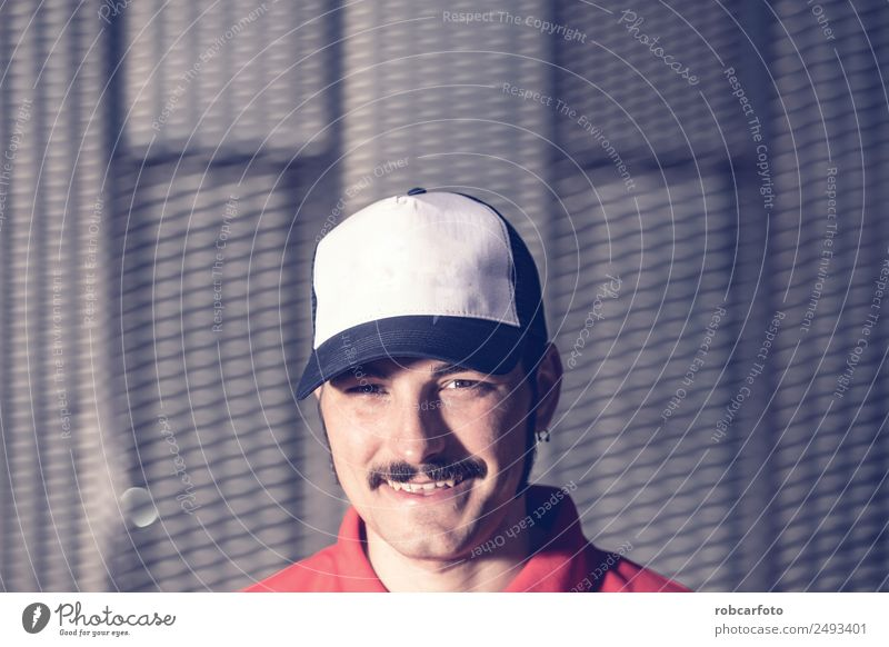 portrait of young man with cap and mustache Man Blue White Face Adults Lifestyle Style Happy Fashion Smiling Stand Cool (slang) Hip & trendy Model Indicate Long