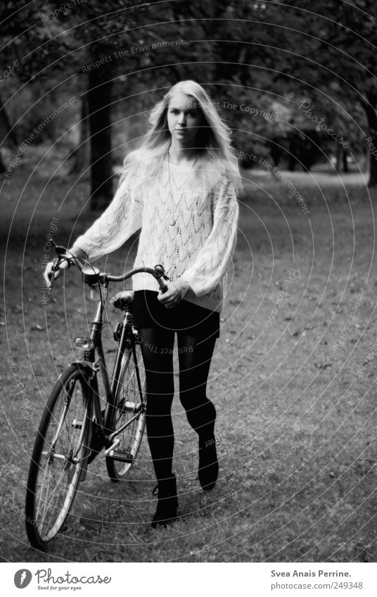 bicycle. Feminine Young woman Youth (Young adults) 1 Human being 18 - 30 years Adults Tree Park Meadow Skirt Sweater Long-haired Bicycle To hold on Thin Push