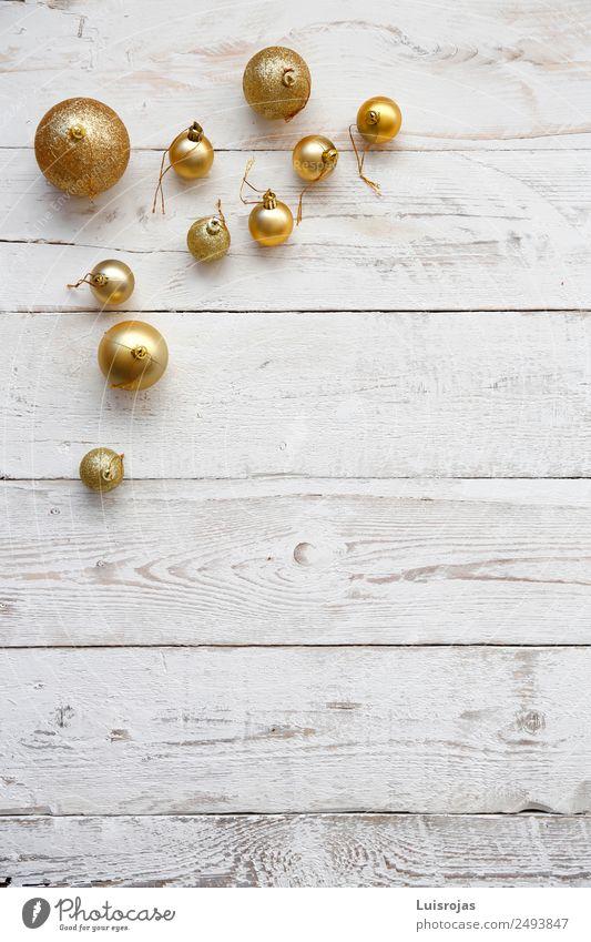 rgolden christmas balls on white wood Christmas & Advent Love Wood Friendship Gold Friendliness Plastic Ornament Hospitality Goodness Altruism