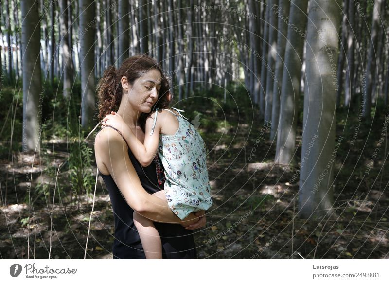 woman hugging her daughter in a forest Child Human being Nature Plant Tree Relaxation Forest Girl Healthy Lifestyle Adults Environment Feminine Freedom Infancy