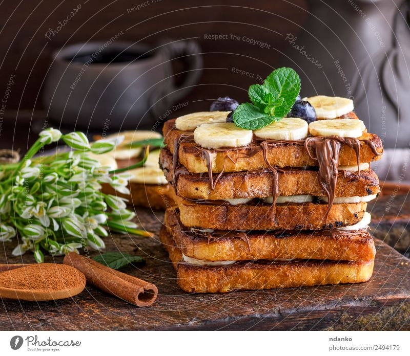 French toast with a banana Fruit Bread Dessert Nutrition Breakfast Flower Wood Eating Fresh Delicious Brown Tradition french Banana chocolate background food