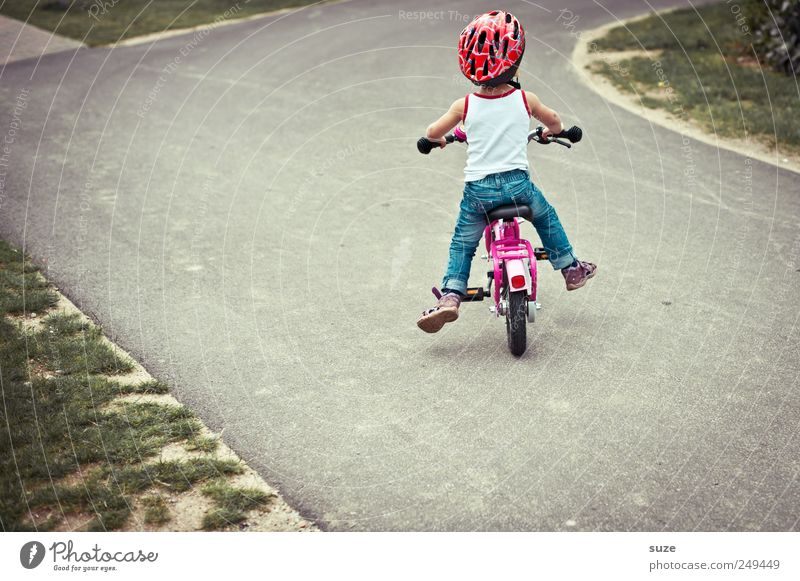 Human being Child Girl Lanes & trails Small Infancy Bicycle Leisure and hobbies Childhood memory Safety Cute Driving Target Toddler Footpath Traffic infrastructure