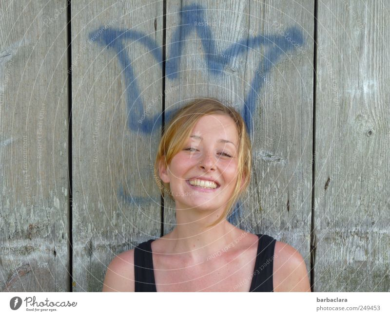 the crowning glory Woman Adults Freckles 18 - 30 years Youth (Young adults) Painter Crown Summer Wall (barrier) Wall (building) Facade Blonde Wood Sign Smiling