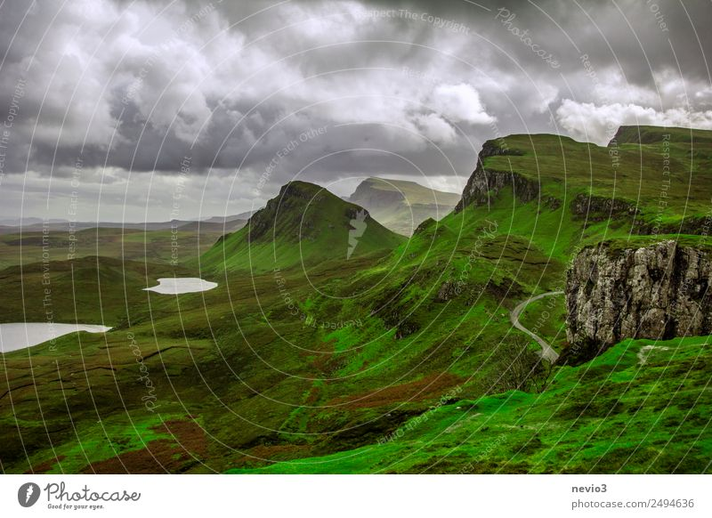 The Quiraing on the Isle of Skye in Scotland Landscape Autumn Climate Climate change Bad weather Rain Meadow Hill Rock Mountain Lake Wet Beautiful Green
