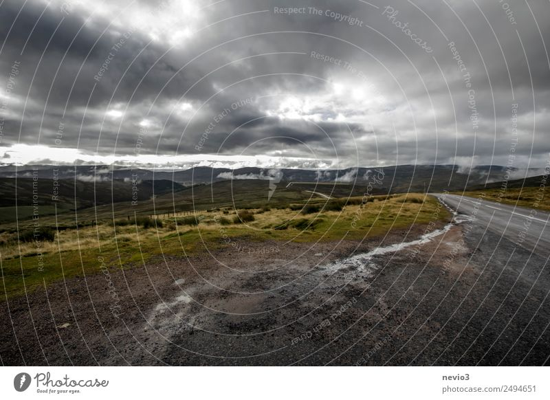 Dark clouds over the Scottish Highlands Landscape Meadow Field Threat Dirty Cold Wet Gloomy Brown Gray Hill Gravel road Gravel path Scotland Europe