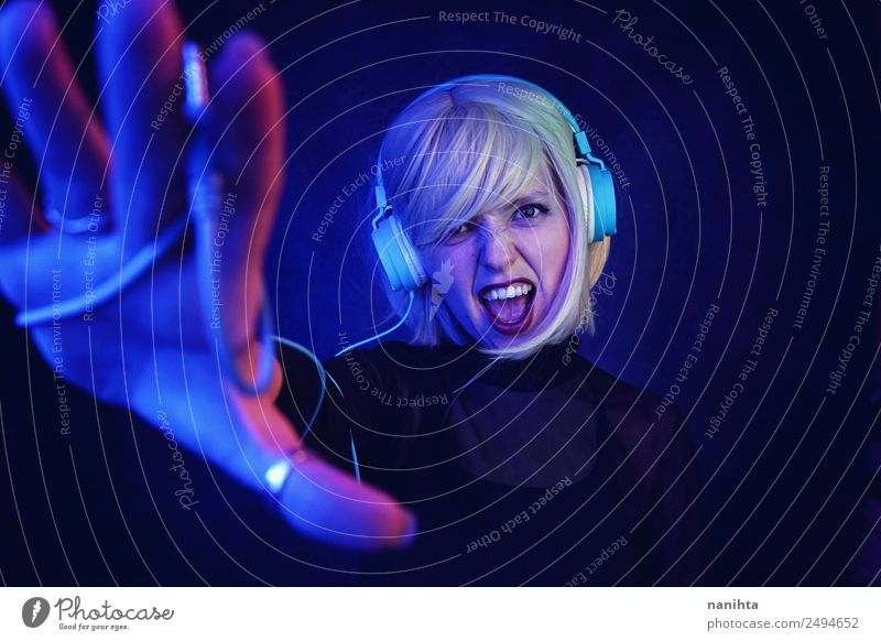 Young and strong DJ woman Lifestyle Style Design Night life Entertainment Party Event Music Disc jockey Going out Feasts & Celebrations Headset Headphones