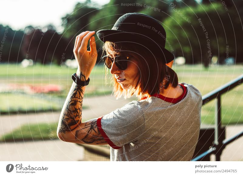 [LS107] - Young woman with sunglasses, hat and tattoo in the park Lifestyle Style Youth (Young adults) Adults Head Arm Hand 13 - 18 years 18 - 30 years Summer