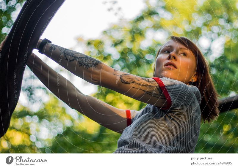 [LS102] - Young woman with tattoo on her arm in the park Lifestyle Wellness Well-being Contentment Relaxation Cure Leisure and hobbies Hiking Going out Feminine