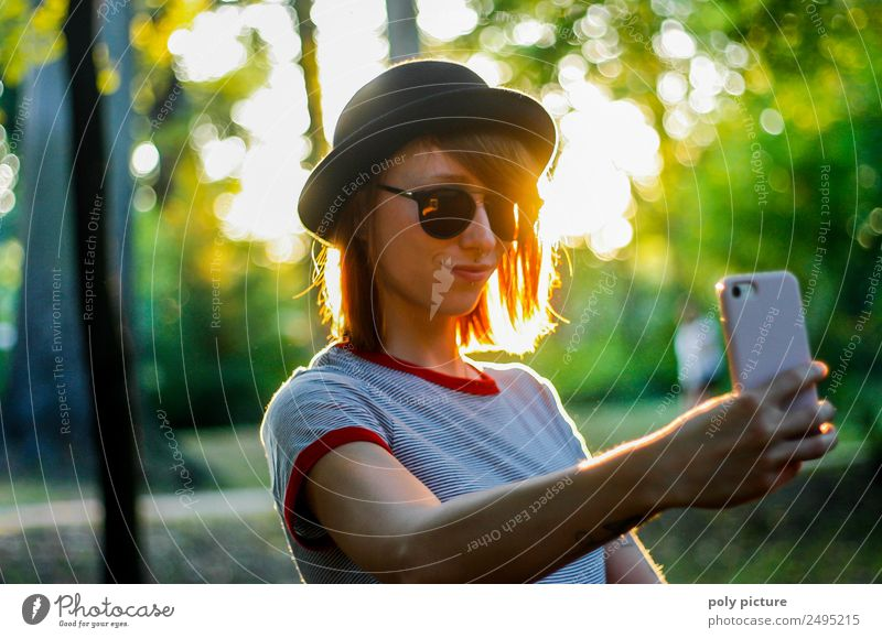 [LS103] - Young woman with a hat makes a selfie in the park PDA Feminine Youth (Young adults) Adults Life Human being 18 - 30 years Contentment Pride Addiction