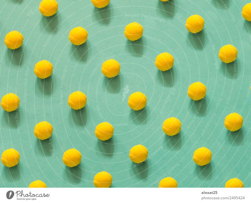 Yellow tennis ball patter on green background Green Relaxation Sports Playing Design Leisure and hobbies Decoration Photography Ball Sphere Conceptual design