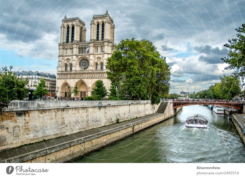 Notre Dame Cathedral and Sena river Style Vacation & Travel Tourism Landscape Sky Clouds Weather River Church Bridge Architecture Facade Monument Stone Old